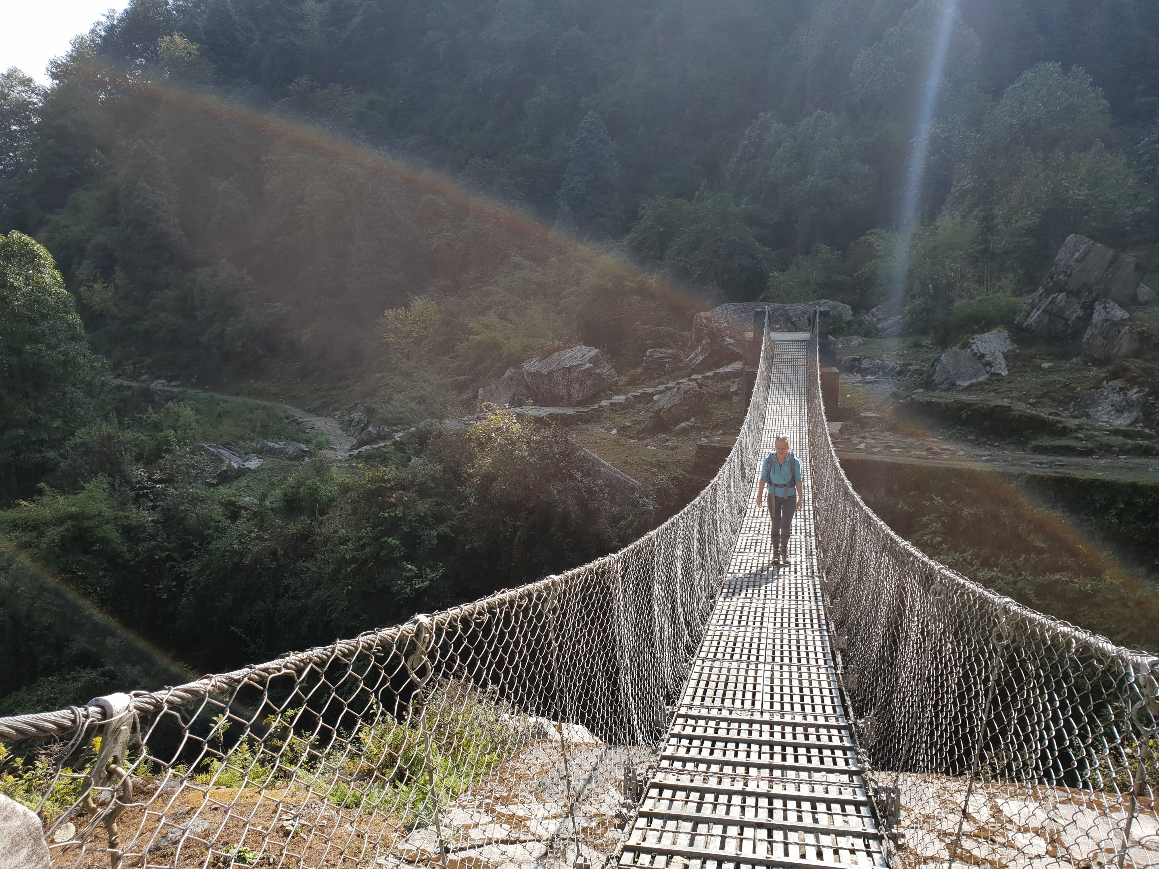 """One of the many steel """"rope bridges"""" we crossed on our way. Most of these were provided by the Gurkhas."""